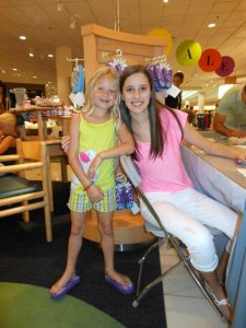 Madison in Nordstrom meeting with one of her customers.
