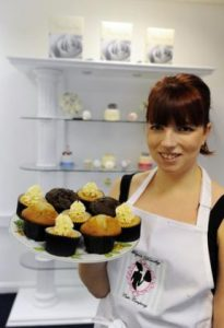 Megan with a plate of fresh baked cupcakes. Photo Courtesy: Echo News.