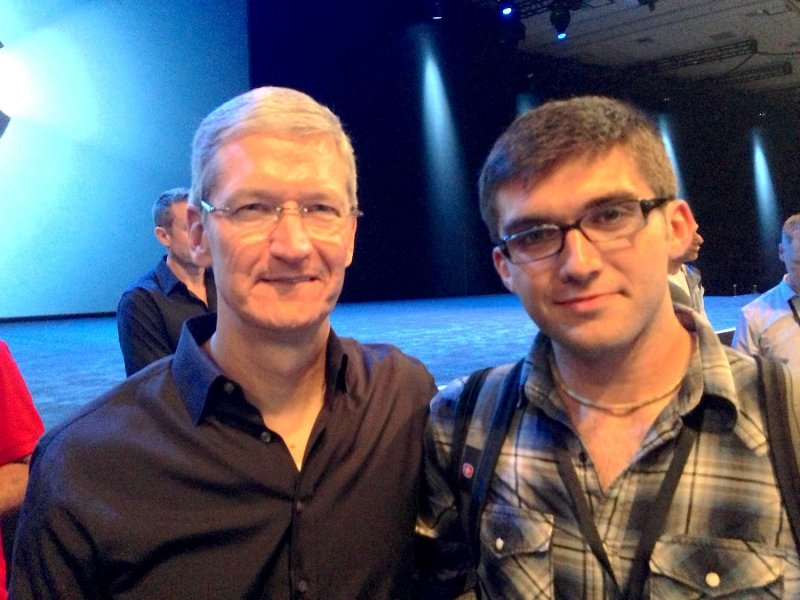Apple CEO, Tim Cook standing with John Meyer